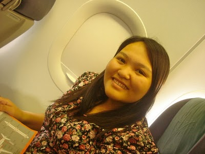 Seated beside the plane window. :)
