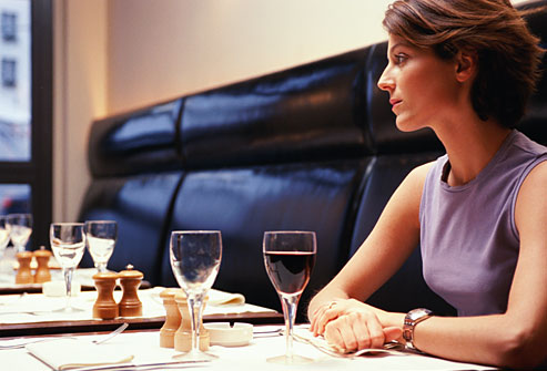 getty_rm_photo_of_woman_waiting_at_restaurant_table